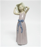 "RETIRED COLLECTIBLE LLADRO FIGURINE ""TRYING ON A STRAW-HAT"""