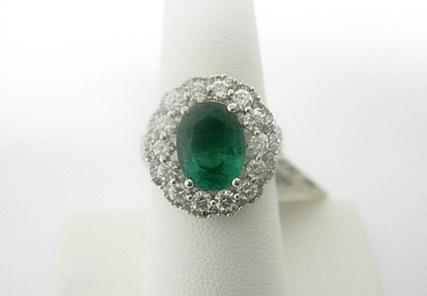 18K EMERALD AND DIAMOND RING 4.10 C.T.W.