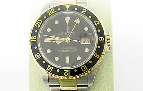 ROLEX MENS GMT MASTER II 18K AND STAINLESS STEEL WATCH