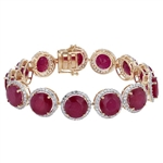 YELLOW GOLD OVER STERLING SILVER RUBY AND WHITE SAPPHIRE BRACELET 71.50 C.T.W.