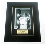 HAND SIGNED YOGI BERRA 4X5 IN A 8X10 MATTED DISPLAY