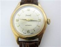 CONTENT OF SAFE DEPOSIT BOX. PIAGET MENS WATCH