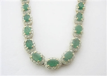 14K EMERALD AND DIAMOND NECKLACE 18.47 C.T.W.