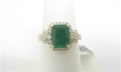 14K EMERALD AND DIAMOND RING 3.24 C.T.W.