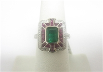 PLATINUM EMERALD, RUBY AND DIAMOND RING 3.00 C.T.W.