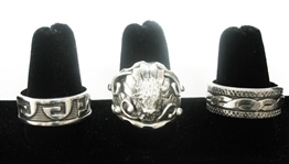 THREE ASSORTED STERLING RINGS