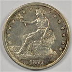 NEARLY MINT STATE 1877-S TRADE SILVER DOLLAR. AU58+