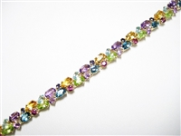 "10 CT ""RAINBOW"" GEM HEAVY 14K YG TENNIS BRACELET"