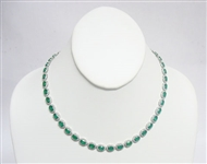 14K EMERALD AND DIAMOND NECKLACE 27.34 C.T.W.